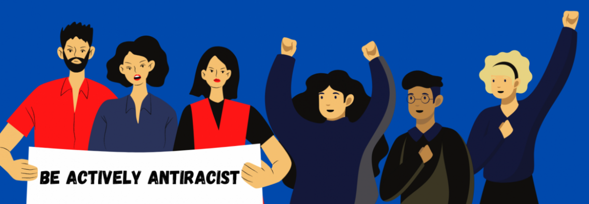 Be actively antiracist is on a sign that protesters are holding in support of the AAPI community. Some protesters are wearing red, black, and navy, while against a blue background.